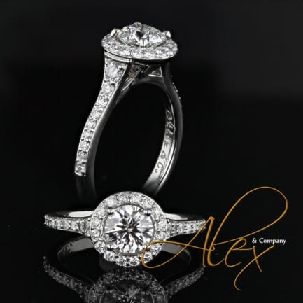 platinum engagement ring with round and pave diamond